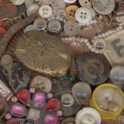 Doll covered in letters & buttons
