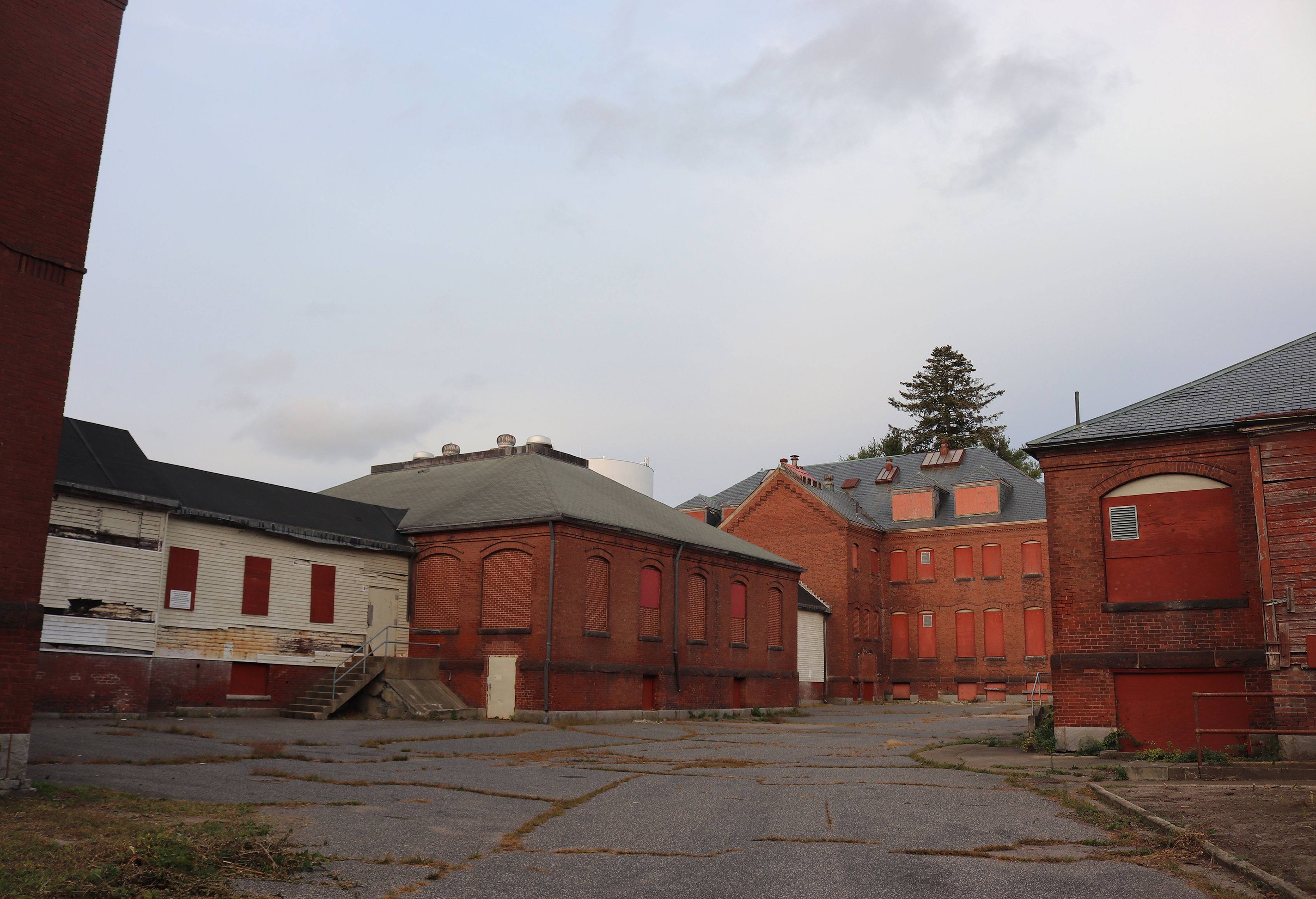 Wide shot of abandoned hospital